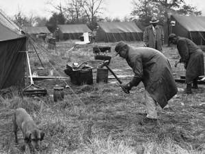 Two African-American men drive the final stakes into the ground after putting up a new tent at Tent City, which was built for evicted tenant farmers in Fayette County, Tenn., on Dec. 30, 1960. African Americans taking up residence in the tents claim the evictions were ordered in retaliation against those who registered to vote. (Photo: Associated Press file photo)